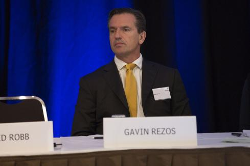 Rezos cuts back board commitments