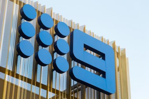 Nine to cut costs as profit slumps