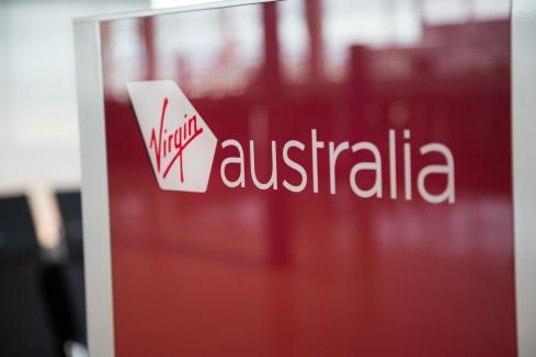Virgin reduces fleet, forecasts virus hit