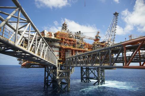 Oil slump hits Woodside $US4.4bn