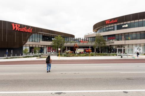 Westfield operator swings to half-year profit