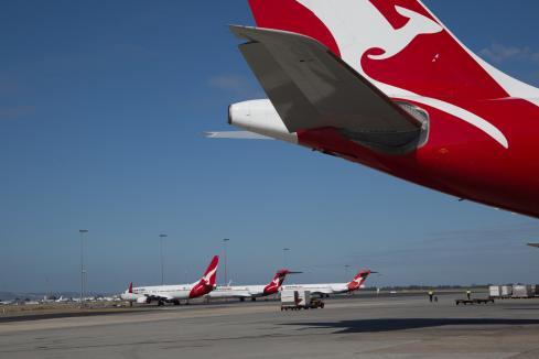 Qantas in $802m land sale to reduce debt