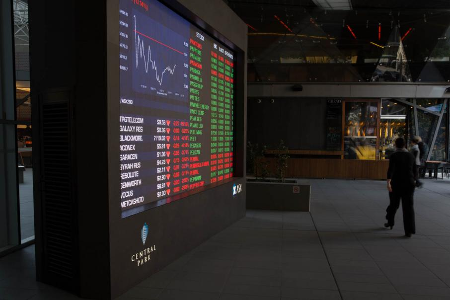 Aust shares hit by drop in commodities