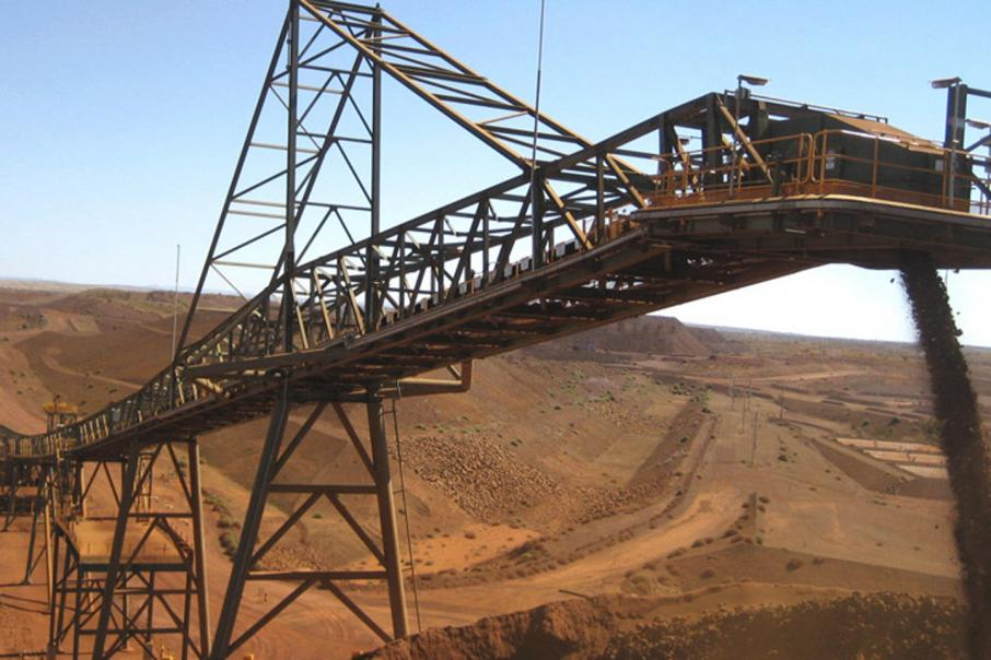 China demand lifts BHP iron ore output